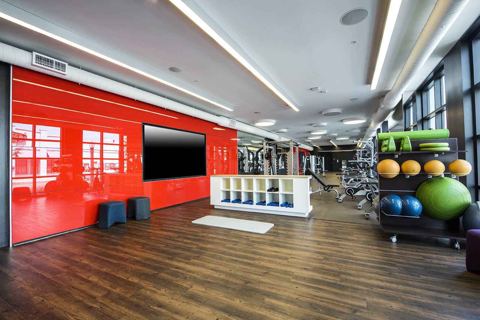 Fitness center with multiscreen fit wall at Malden Station by Windsor, California