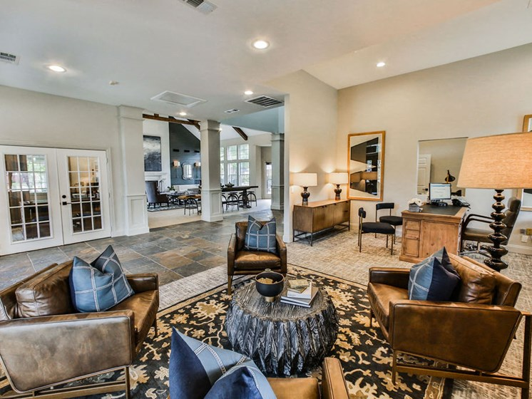 Community lounge seating area with fireplace