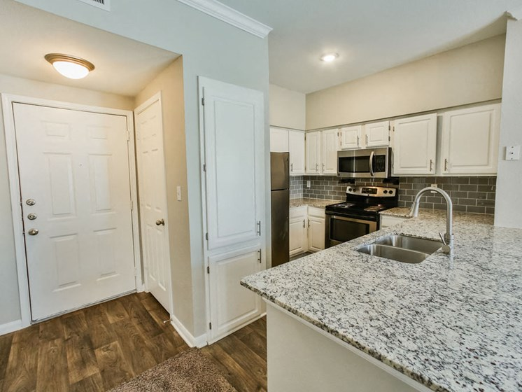 White Oak Floorplan kitchen with  sink and microwave