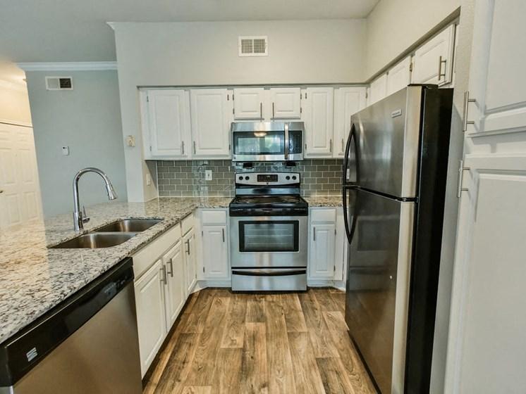 Graves Floorplan, unfurnished kitchen with microwave