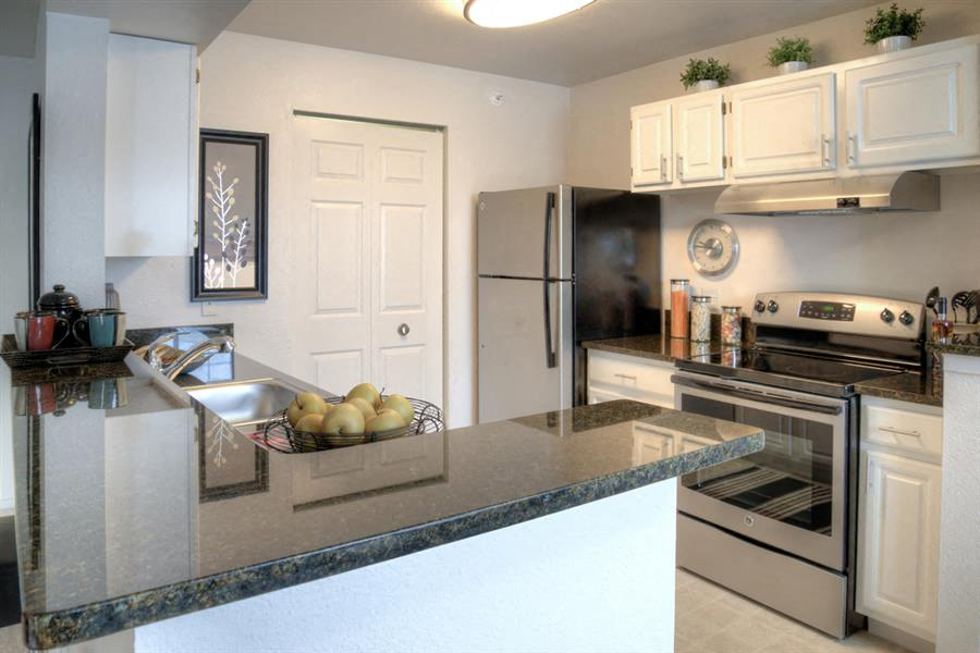 Granite Countertops, White Cabinets and Silver Appliances at Orion Main Street, Ann Arbor, MI
