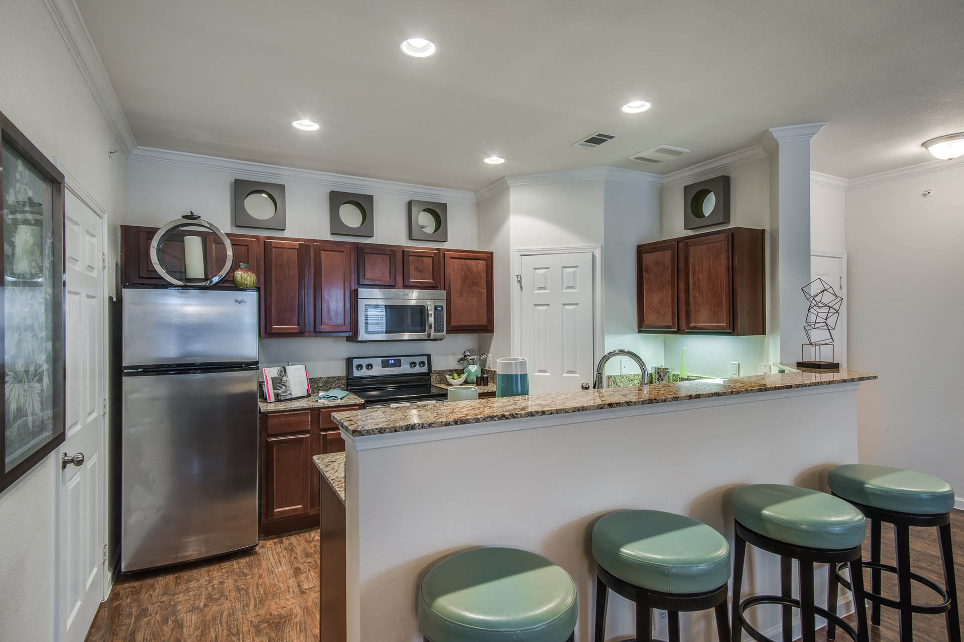Kitchen with Breakfast Bar at Orion Prosper, Prosper, TX, 75078
