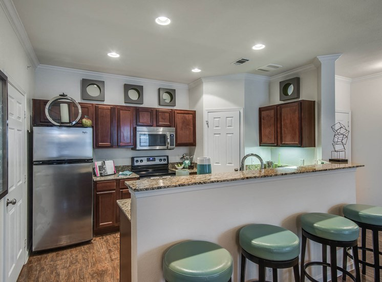 Kitchen with Breakfast Bar at Orion Prosper, Prosper, TX, 75078