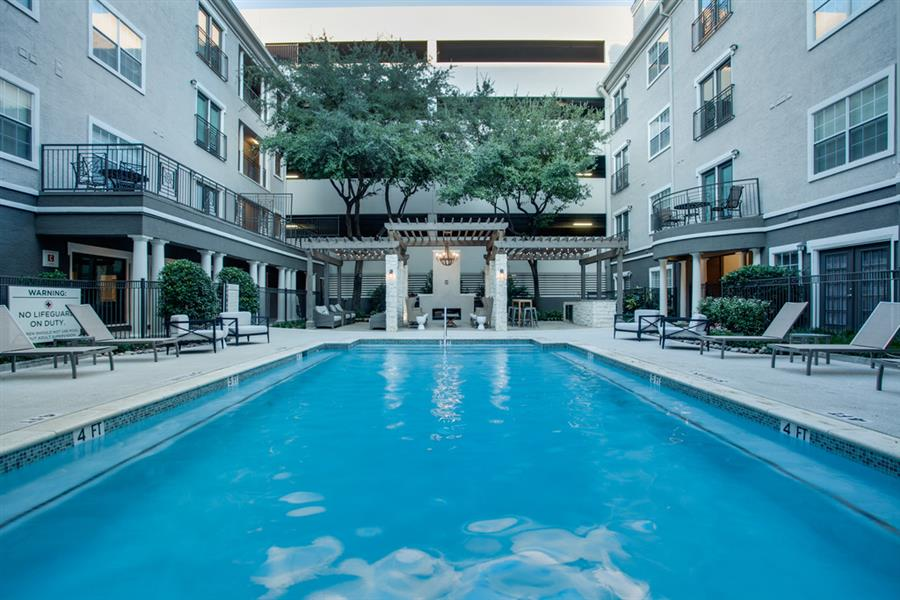 A Resort- Inspired Pool with Adjacent Tanning Deck at Chelsea on Southern, Dallas, 75240