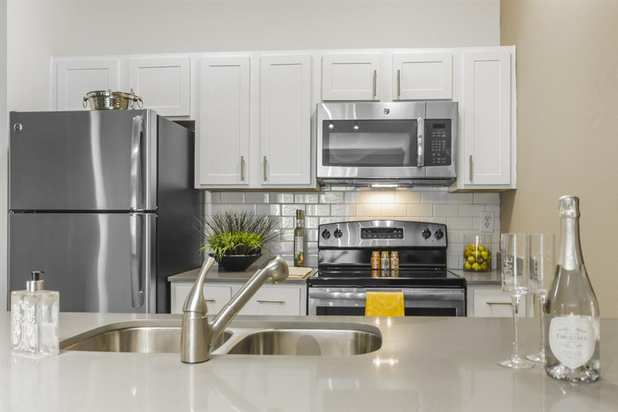 White Cabinetry with Energy Efficient Appliances at Chelsea on Southern, Texas, 75240