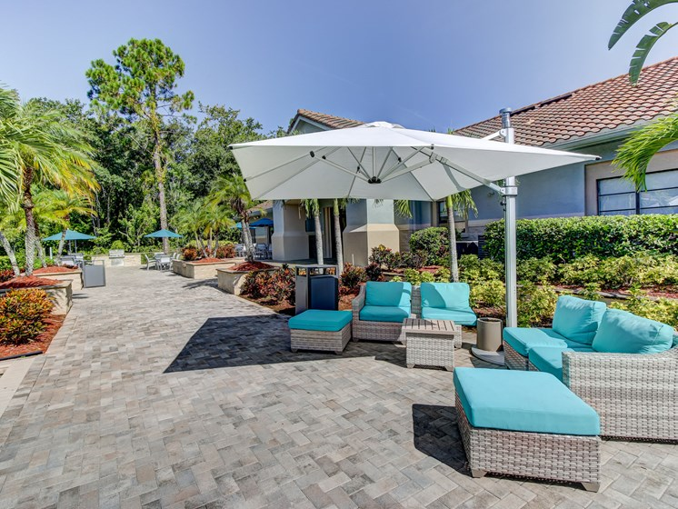 Swimming Pool Area With Shaded Chairs at The Preserve at Westchase, Tampa, Florida