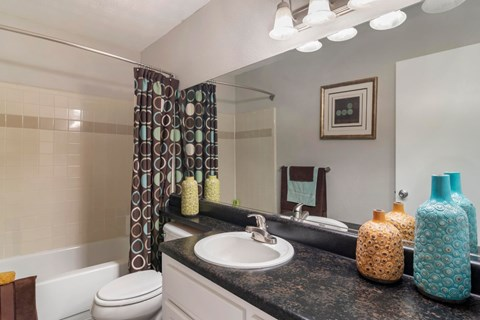 Decorated Bathroom with Vanity Lights and Garden Style Tub