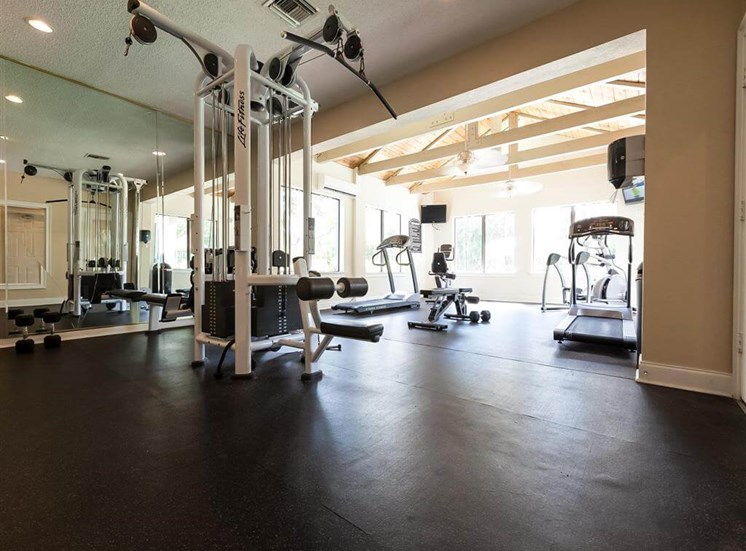 Spacious Fitness Center with Exercise Equipment  and Large Windows
