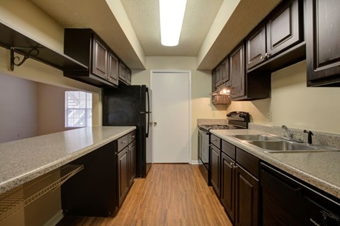 Fully Equipped Kitchen with Black Appliance Package
