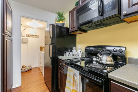 Landmark at Wynton Pointe | Fully Equipped Kitchen with Black Appliances