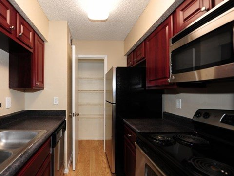 St. James Crossing | Apartments for Rent in Tampa, FL | Cherry Cabinetry in Kitchen