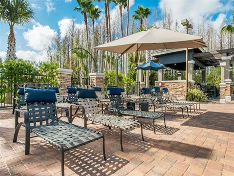 The Parkway at Hunters Creek | Apartments for Rent in Orlando, FL | Swimming Pool with Lounge Seating