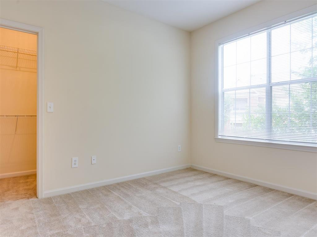 Bedroom with Closet | Village at Almand Creek Apartments Conyers, GA