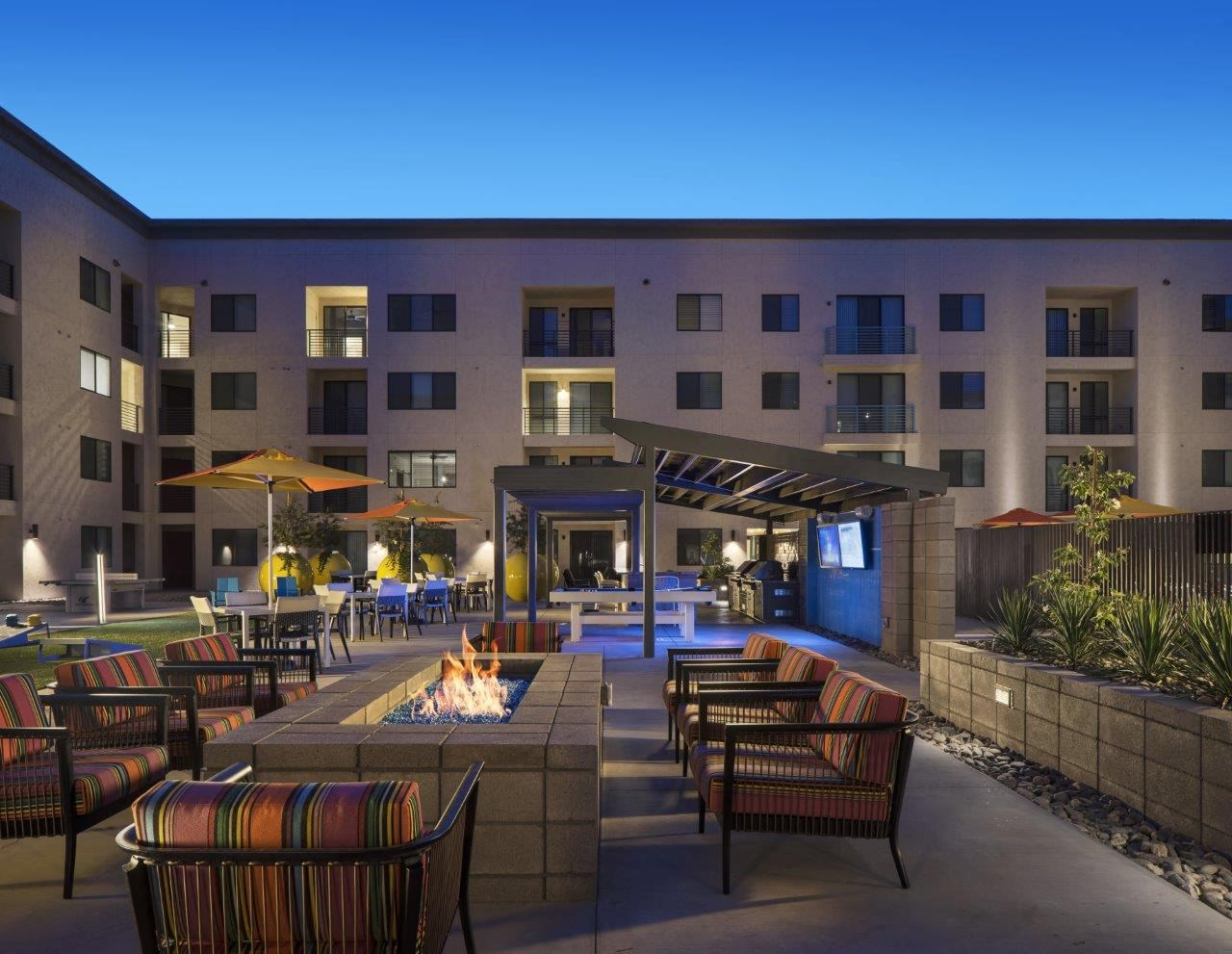 Outdoor entertainment ramada with TVs and Pool table