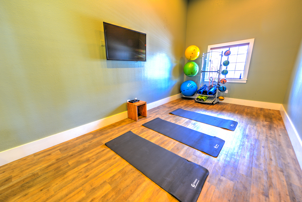 Fitness and stretching room at Century Deerwood Park