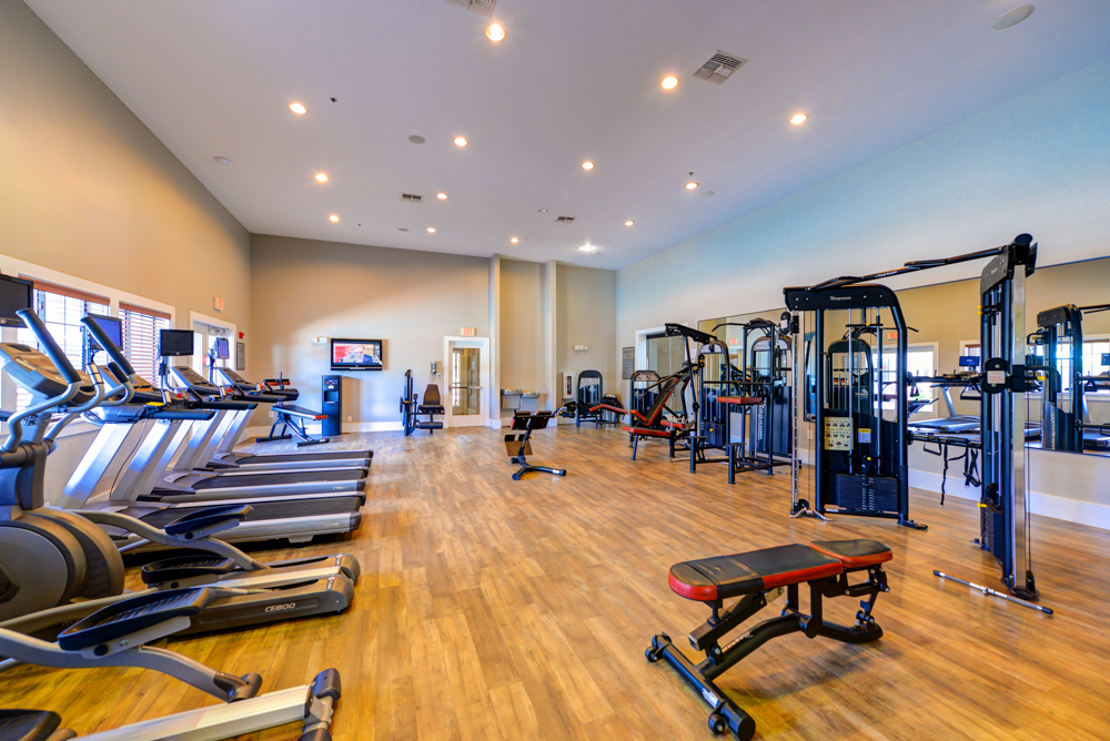 Fully equipped fitness center at Century Deerwood Park
