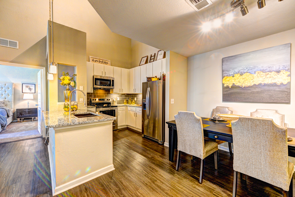 Spacious dinning area and modern kitchen at Century Deerwood Park