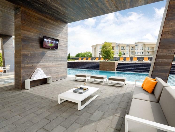 outdoor lounge area near pool