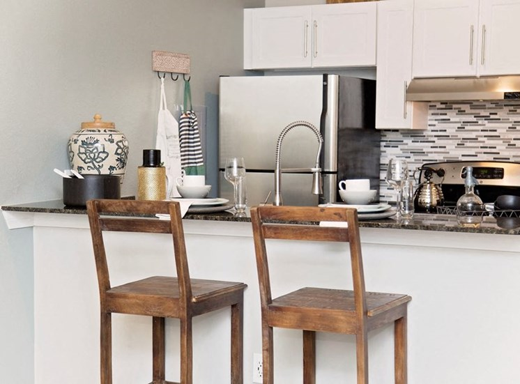 Two bar stools at model home kitchen counter