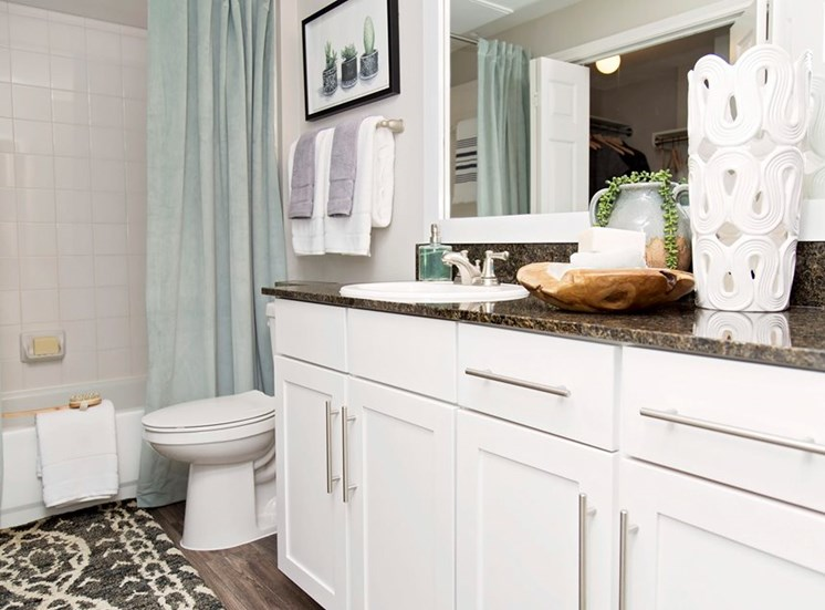Model bathroom with white cabinets