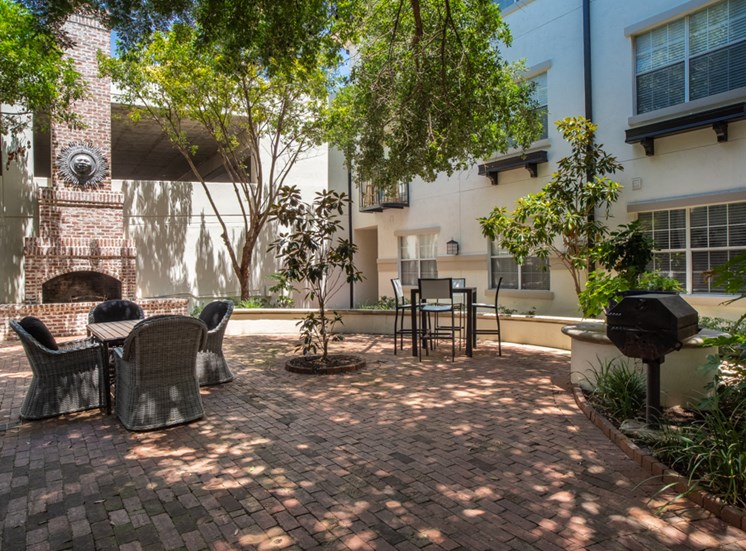 Shaded patio area with outdoor tables and chairs