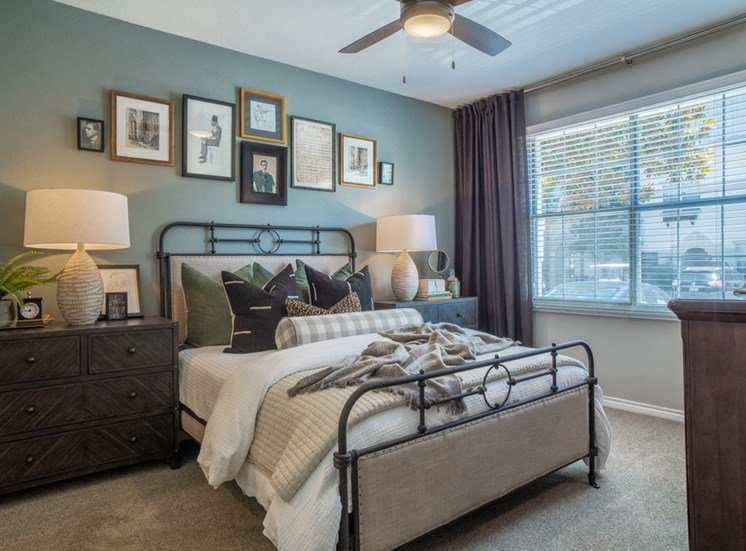 Model master bedroom bed and nightstand