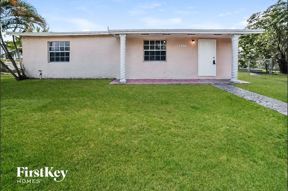 000 photo front view 8767038 - Honey Hill Park Townhomes Miami Gardens