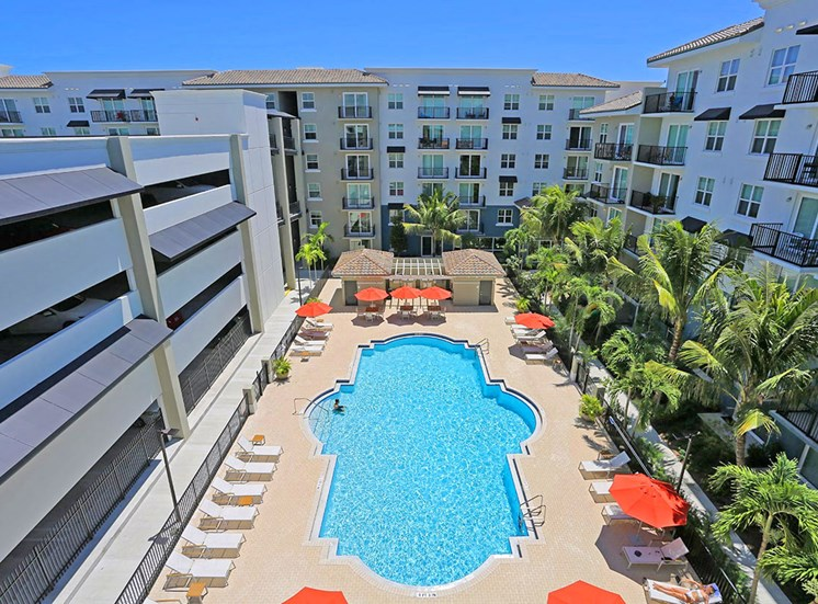 Santorini apartments in Florida features a large pool area and resident parking garage
