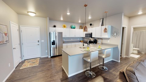 kitchen, grand apartments, fargo apartments, copper light fixtures, white cabinets