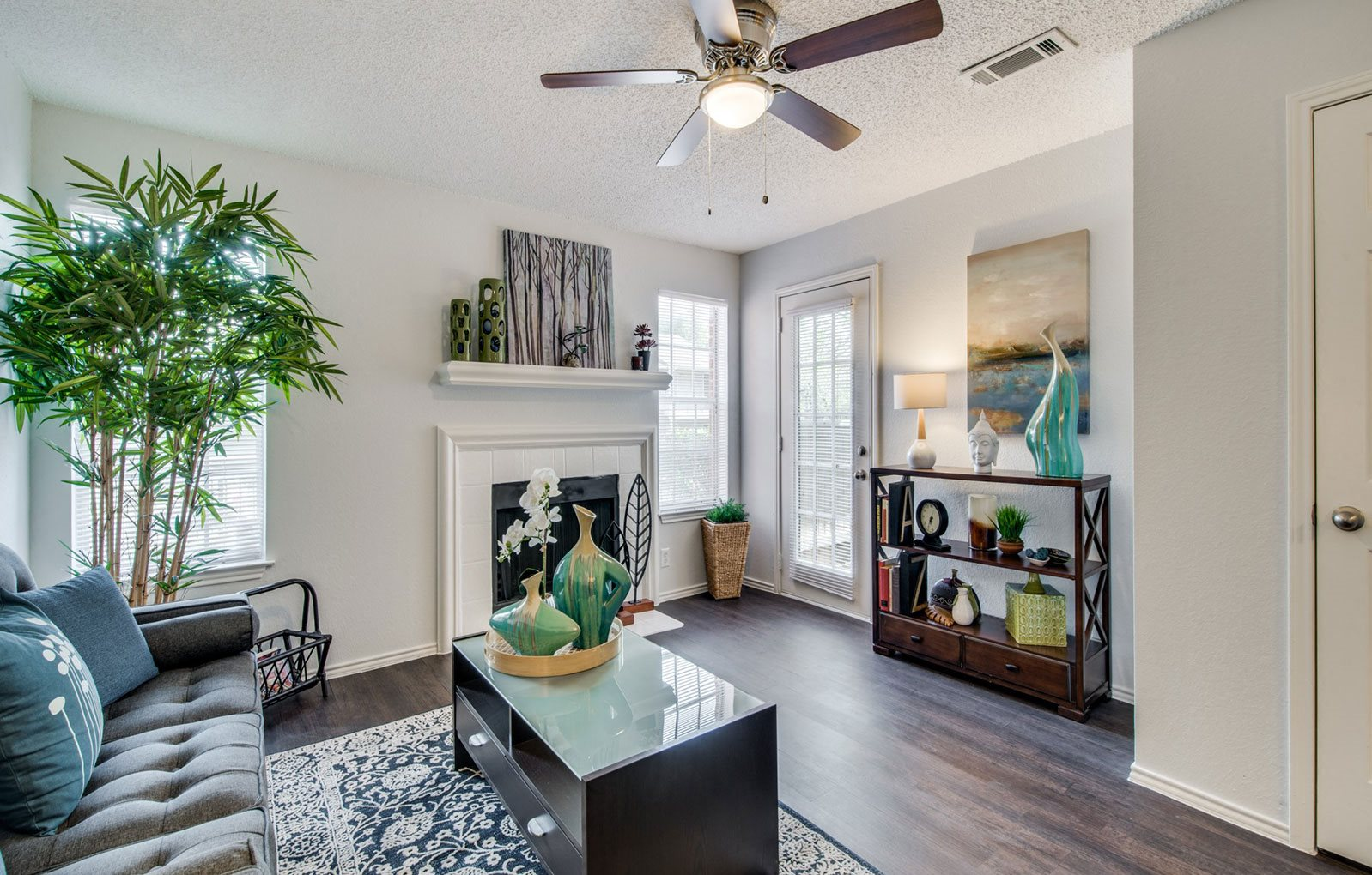Living Room With Standard Fireplace at CLEAR Property Management , Wildwood Apartments, Texas, 78752
