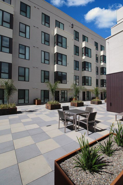 Courtyard seating l Coliseum Connection Apartments in Oakland, CA