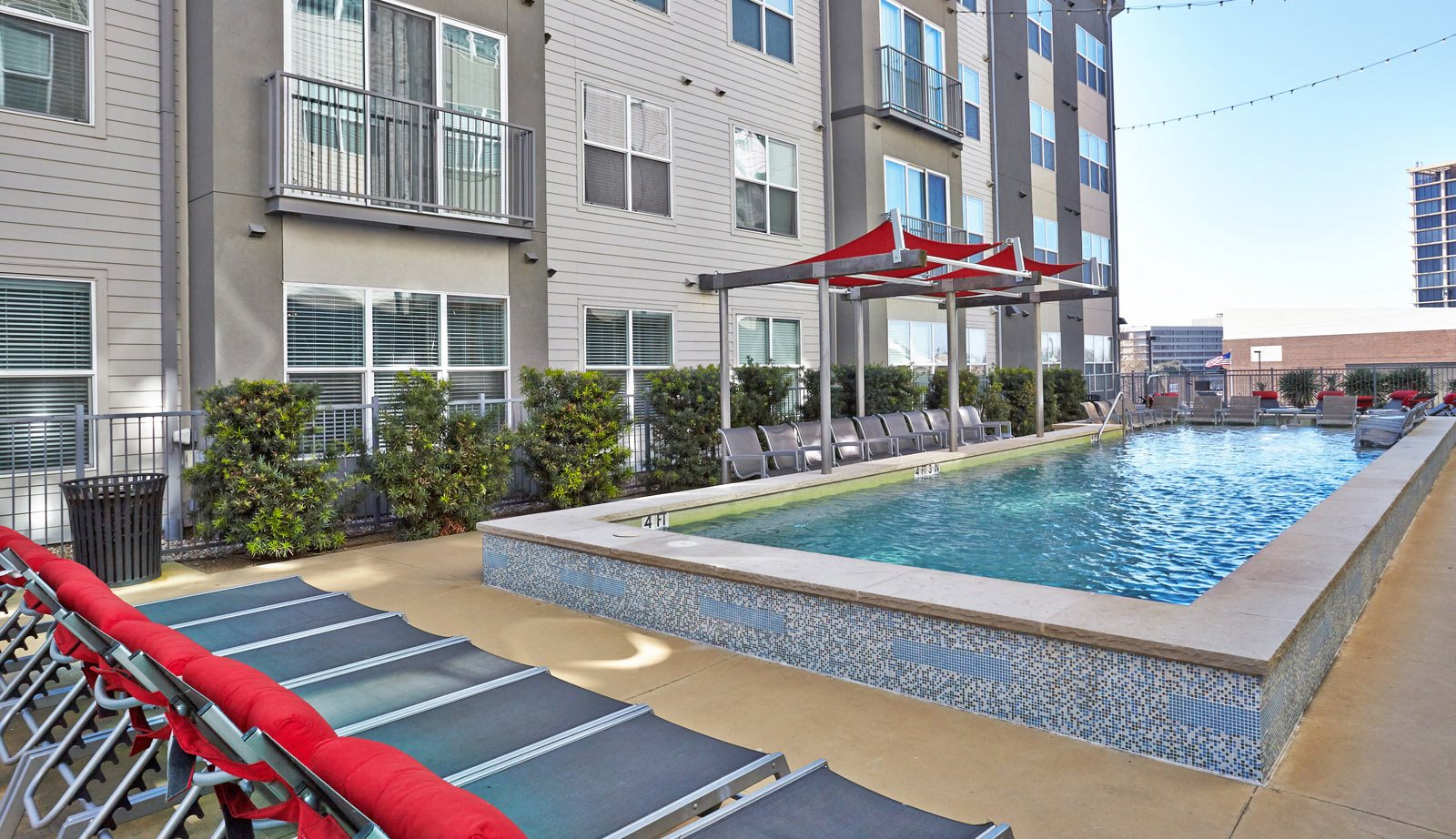outdoor swimming pool with sundeck | Mockingbird Flats Apartments in Dallas, TX