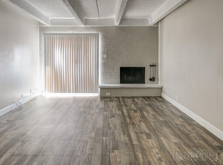 Vacant apartment home living room with fireplace