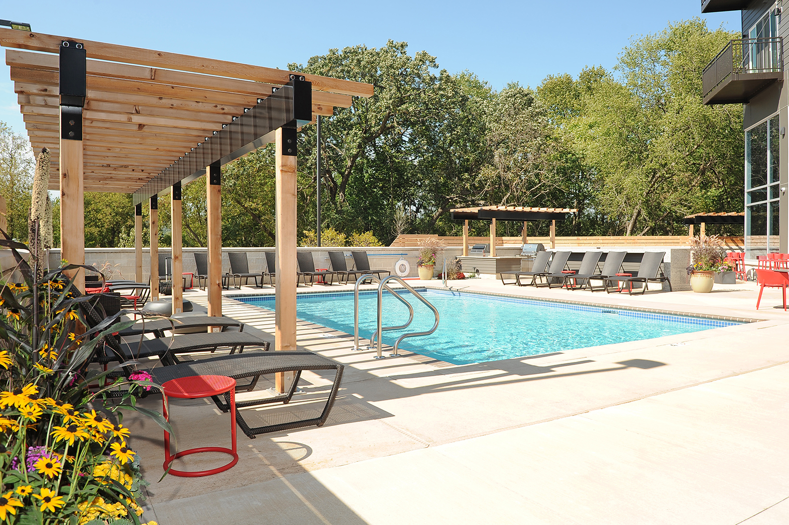 Luxurious Pool with Sundeck at Red44, Rochester, MN