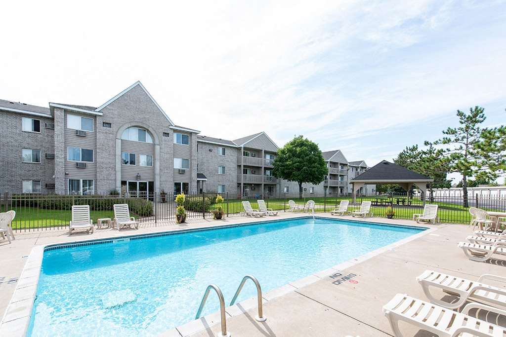 Lounging by the Pool at Wedgewood Park Apartments, Coon Rapids, Minnesota