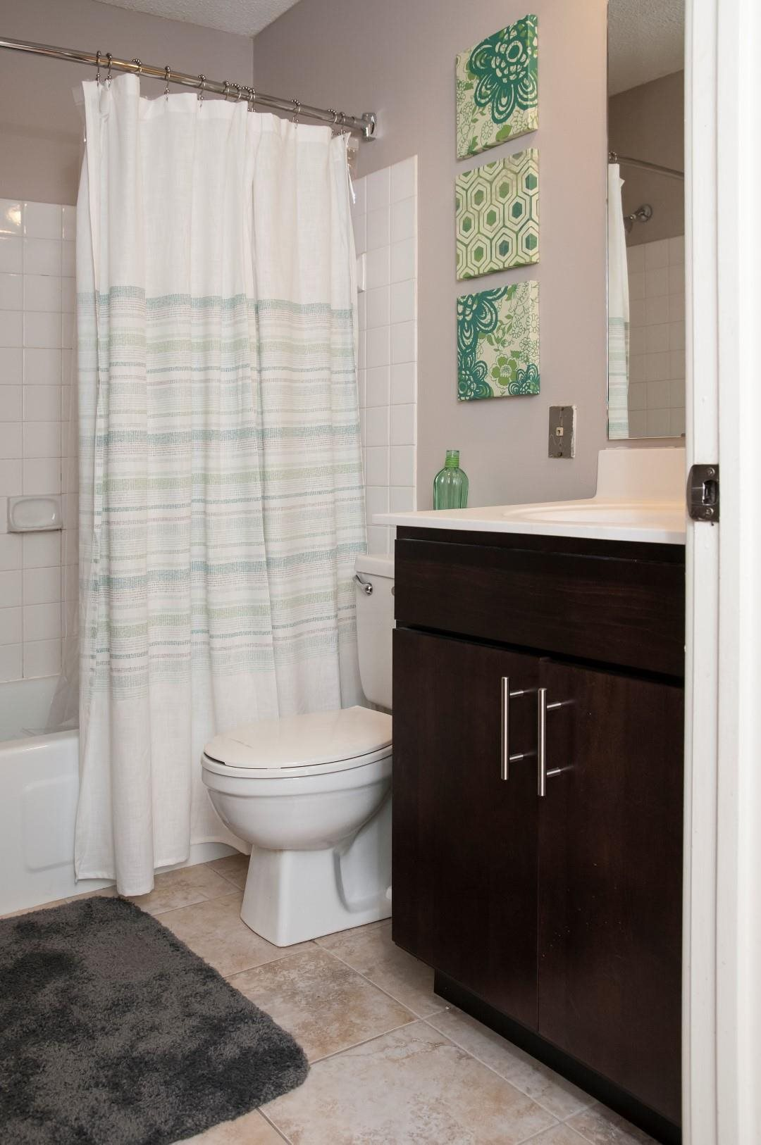 Bathroom with Linen Closet Space and Large Tub at Terra Pointe Apartments, Minnesota, 55119