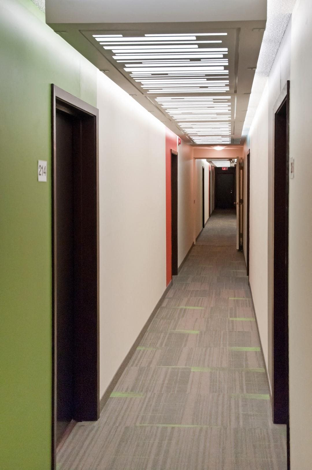 Bright Multicolored Hallway at 2800 Girard Apartments