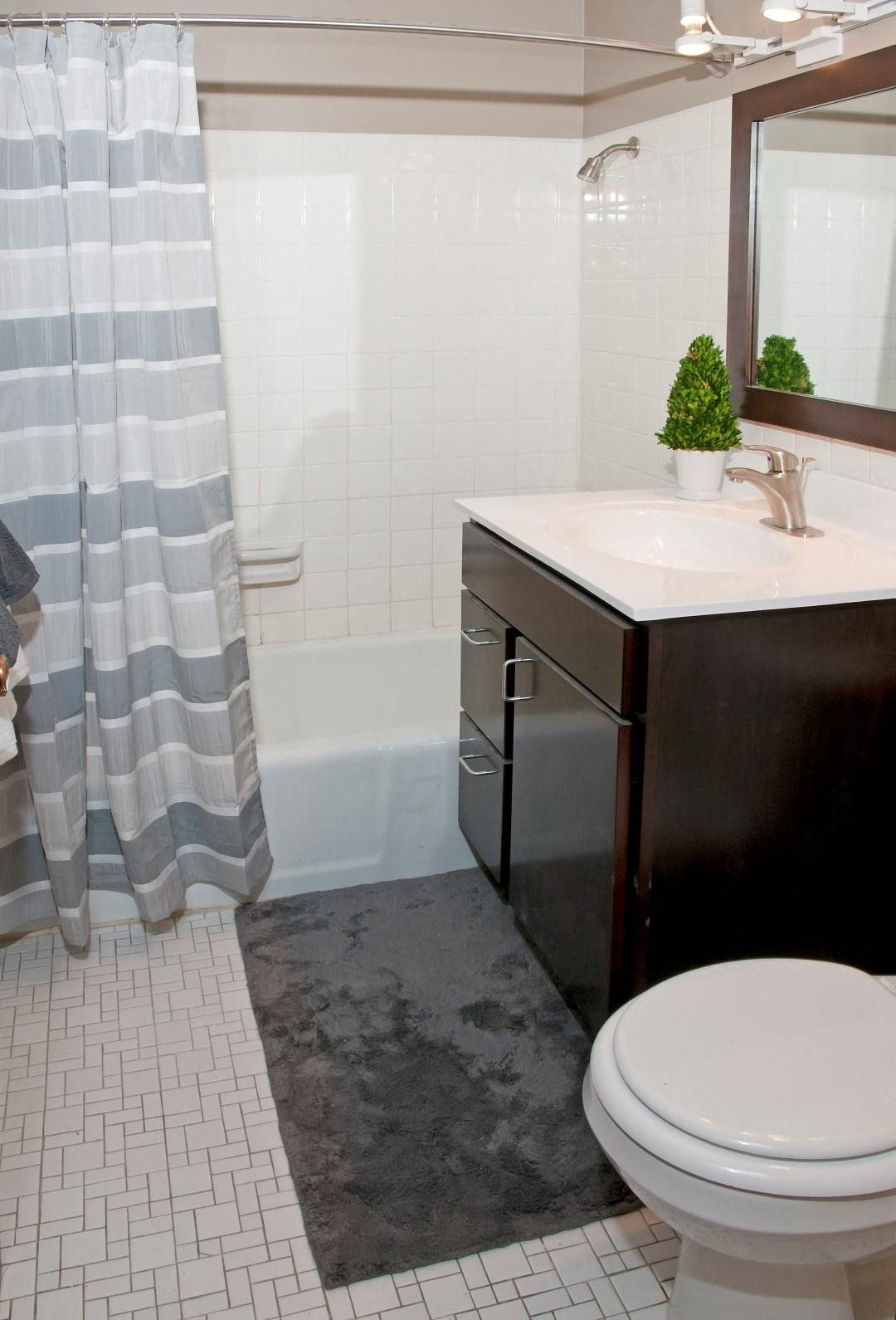 White Tile Bathroom with Large Tub and Shower at 2800 Girard Apartments in Minneapolis, MN