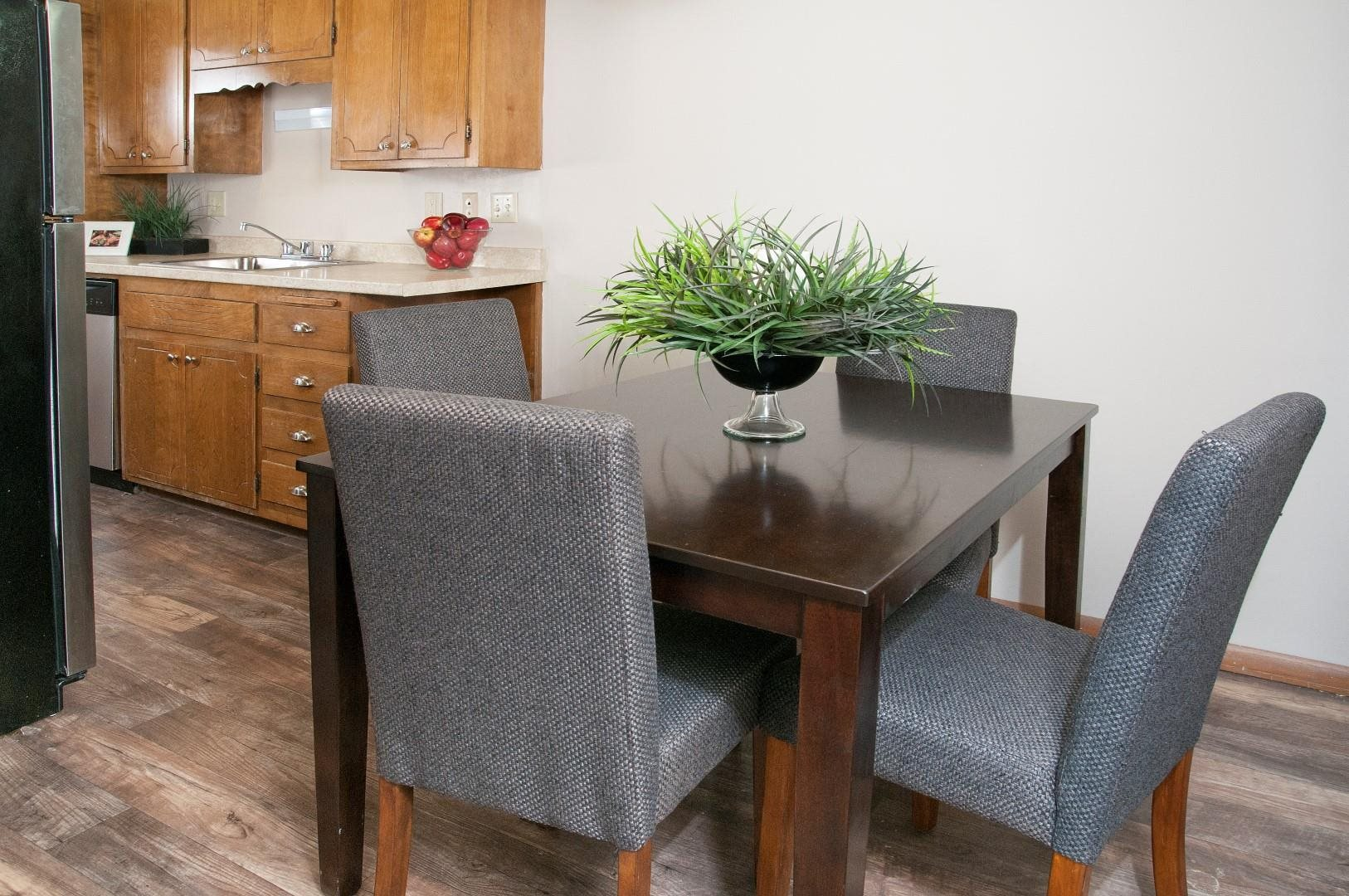 Dining Room Connected to Kitchen With Hard Wood Floors in St. Louis Park Apartment