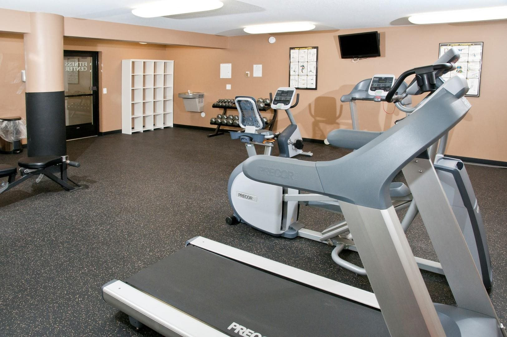 Fitness Room of St. Louis Park Apartment With Cardio Equipment and Free Weights