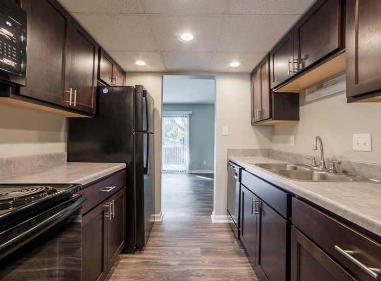 Renovated Kitchens Coming Soon with shaker style cabinets and faux hardwood floors