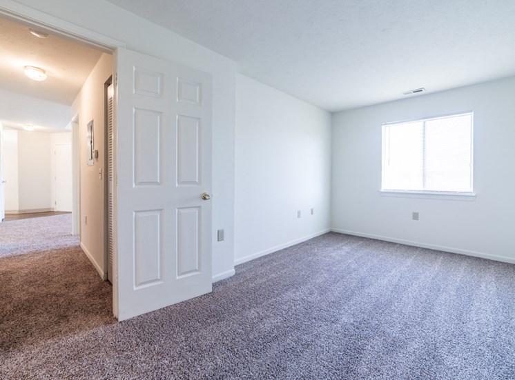Bedroom with window and hallway