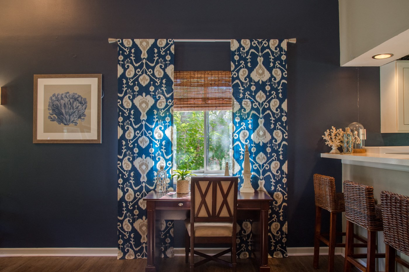 counter top in kitchen with blue curtains
