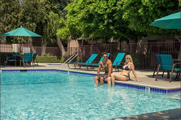Canoga-Park-NMS-West-Hills-Luxury-Apartment-West-Hills-Exterior-Pool-Couple2