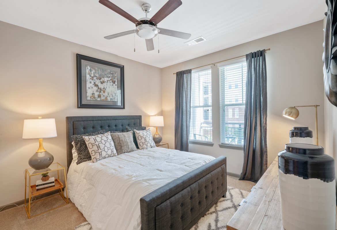 Three Bedroom Apartments in Cornelius, NC - The Junction at Antiquity Apartments Spacious Bedroom with Large Window and Ceiling Fan