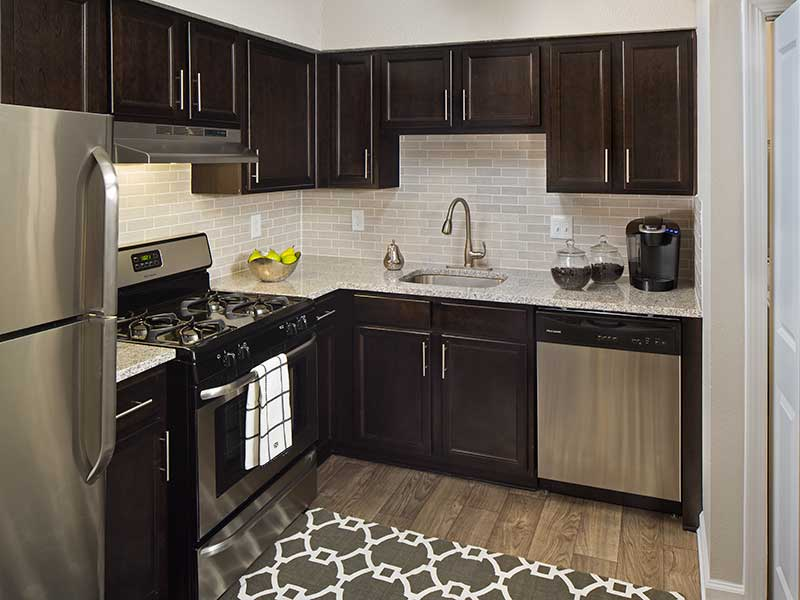 Espresso Cabinetry with Stainless Steel Appliances