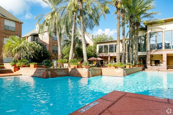 Amenities - Resort-Style Pool View at The Village at Bellaire Apartments in Houston, Texas