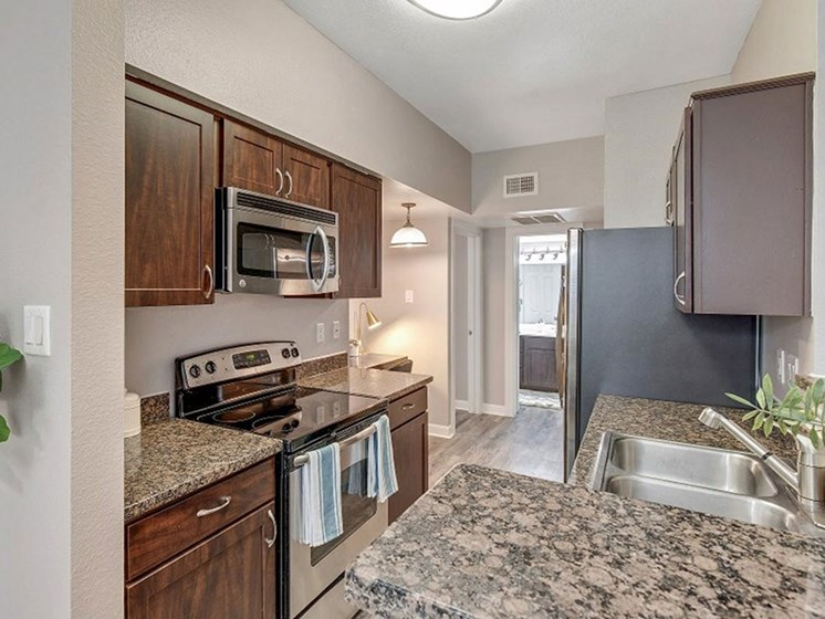Fully-Equipped Kitchen With Marble Counters at The Village at Bellaire Apartments in Houston, Texas