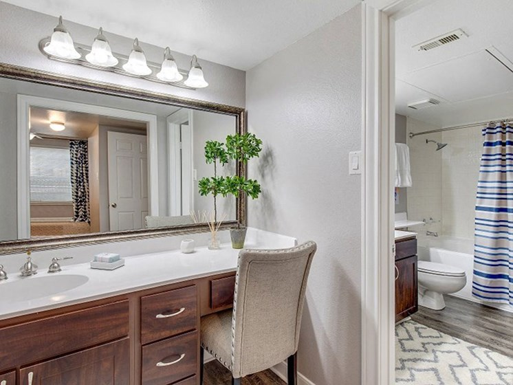Newly Renovated Bathroom With Large Vanity at The Village at Bellaire Apartments in Houston, Texas