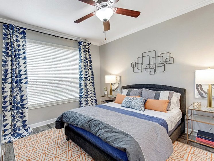 Master Bedroom With Ceiling Fan at The Village at Bellaire Apartments in Houston, Texas